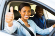 female african learner driver giving thumb up - 69860695