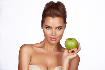 Young beautiful sexy girl with holding big green apple