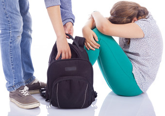 Girl suffering bullying by a boy, isolated on white background