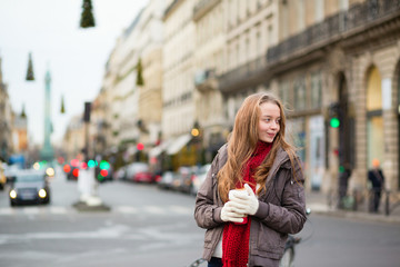 Girl with coffee on a street