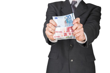 A man holding euro banknotes in front of him with two hands.