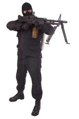 mercenary in black uniforms with machine gun