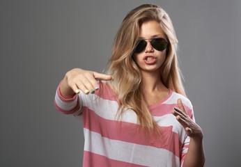 girl doing hand gestures as rap