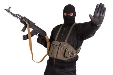terrorist in black uniform and mask with kalashnikov isolated