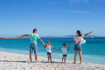 Happy family during summer beach vacation