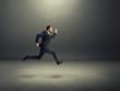 businessman in formal wear running