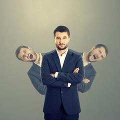 men behind confident businessman
