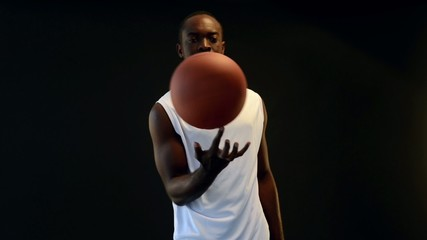 Basketball player spins ball on finger, slow motion