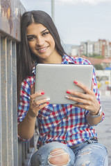 Beautiful brunette business woman with a tablet in her hands