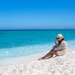 Young beautiful girl enjoying beach tropical vacation