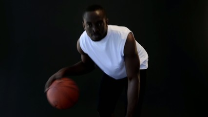 Basketball player with ball, slow motion