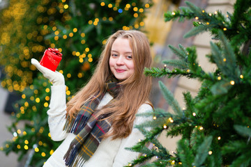 Cheerful girl with Christmas present