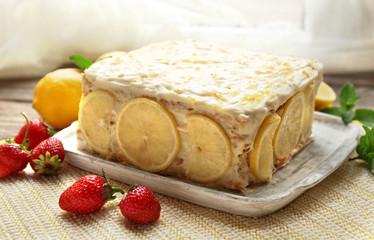 Tasty lemon cake on table at home