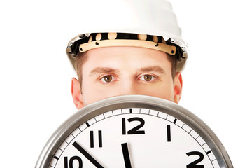 Businessman wearing helmet with clock