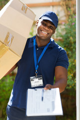 african delivery man carrying parcel
