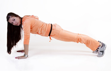 Teen Girl In Orange Sweats Doing Push-up