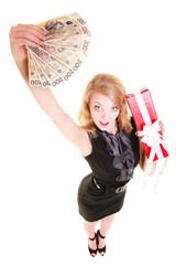 Woman holds christmas gift box and polish money. Holidays.