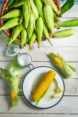 Fresh hot corn served with butter