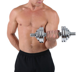 Young muscular sportsman execute exercise with dumbbell