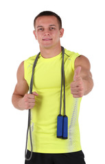Handsome young sportsman holding rope isolated on white