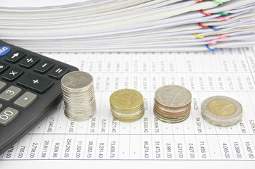 Pile coins and calculator place on finance account
