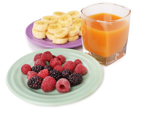 Slices of bananas with berries