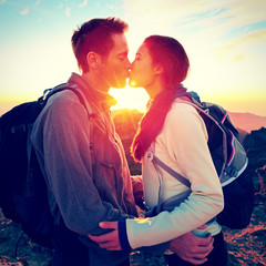 Kiss - couple kissing romantic at hiking sunset