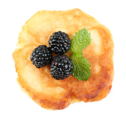 Tasty pancake with fresh berries and mint leaf, isolated