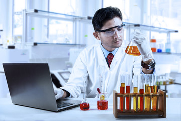 Asian chemist working in laboratory