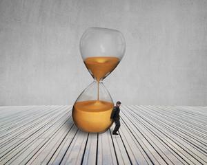 man keeping the tilt hourglass