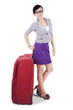 Businesswoman standing with a suitcase