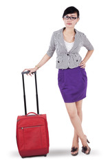 Businesswoman standing with a suitcase 1