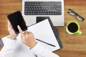 Hands using smartphone to work