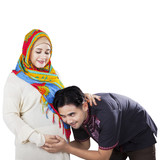 Happy islamic family waiting childbirth poster