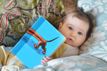 Infant baby read a book