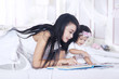 Mother and baby read book