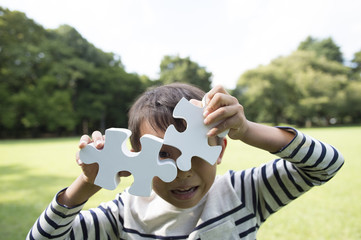 Boy with two big puzzle