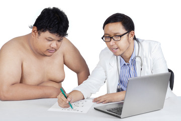 Physician makes a prescription to his patient
