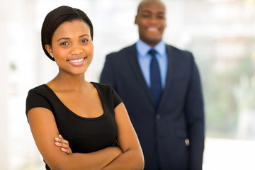 young african businesswoman standing in front of her colleague
