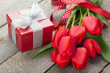 Fresh red tulips with gift box