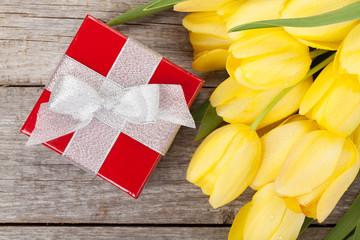 Fresh tulips and gift box