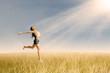 Woman jumping in wheat field