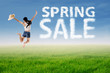 Woman jumps with spring sale cloud