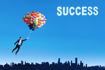 Woman flying with balloons to get her success
