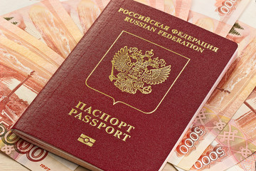Russian passport on the background of the Russian money