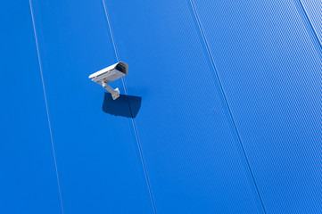 CCTV camera. Security camera on the wall. Private property prote