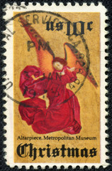 stamp printed in USA shows an angel