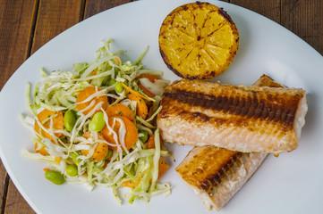 salmon with salad and lemon