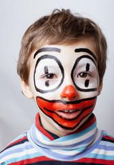 little cute boy with facepaint like clown, pantomimic
