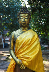 Statue of Buddha in a park near temple in Chiang Mai